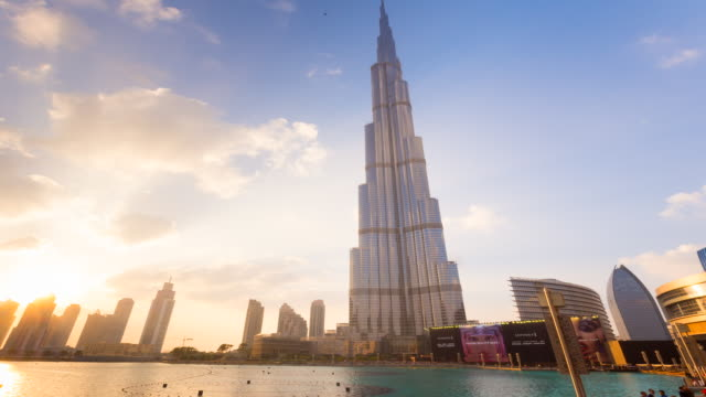 time lapse of burj khalifa at dusk - famous place stock videos & royalty-free footage
