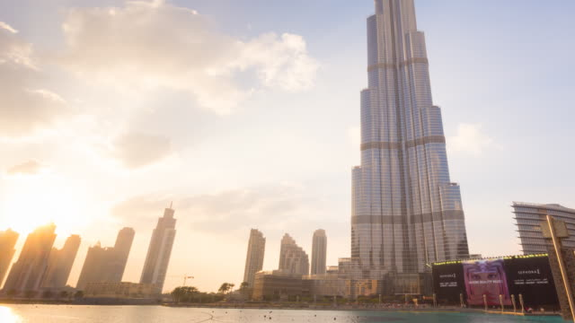 time lapse of burj khalifa at sunset, day to night, zoom out - zoom out stock videos & royalty-free footage