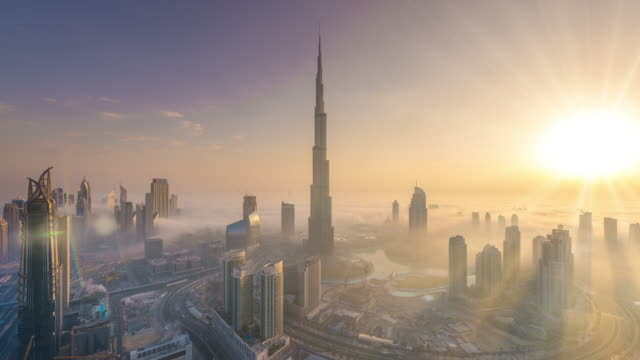 Time Lapse of Burj Khalifa covered in a sea of fog at dawn