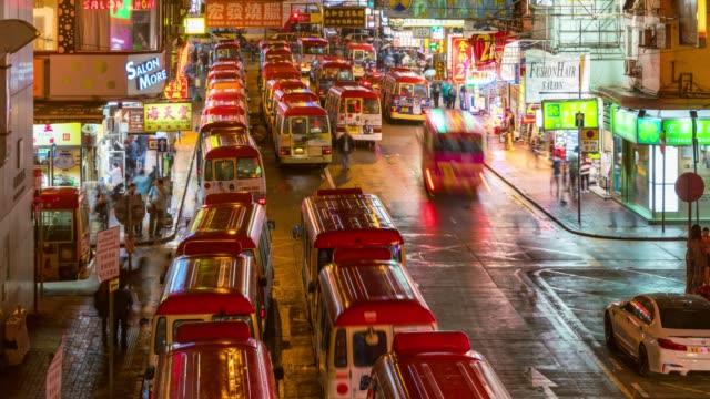 time lapse of bus terminal at fa yuan market and lady market mongkok in kowloon hong kong china at night - tsim sha tsui stock videos & royalty-free footage