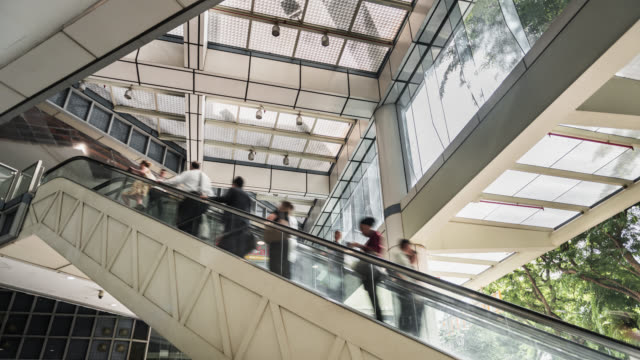 tl/ time lapse of business people and commuters using escalators inside a corporate office building, singapore - martin luther: his life and time stock videos & royalty-free footage