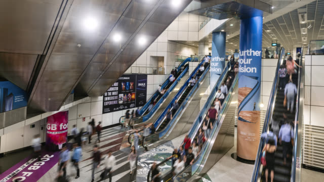 tl/ time lapse of business people and commuters using escalators inside an underground train subway station, singapore - rolltreppe stock-videos und b-roll-filmmaterial