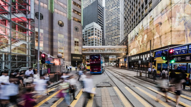 time lapse of busy street on hong kong island, at pedestrian crossing - hong kong island stock videos & royalty-free footage