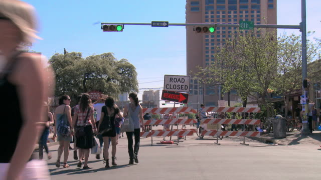 time lapse of busy street with road closed - road closed sign stock videos & royalty-free footage
