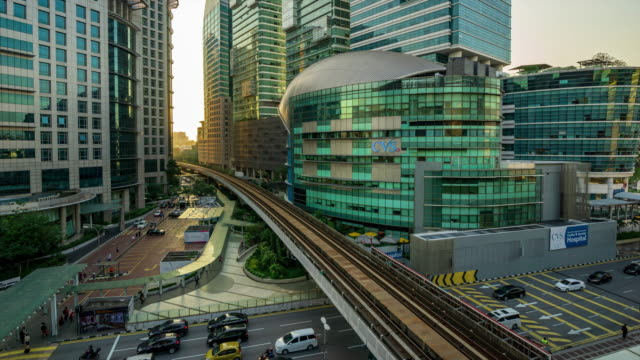 Time lapse of busy traffic of cars and train over downtown of Kuala Lumpur, Malaysia.
