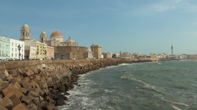 time lapse of cadiz spain boardwalk on a sunny day - time of day stock videos and b-roll footage