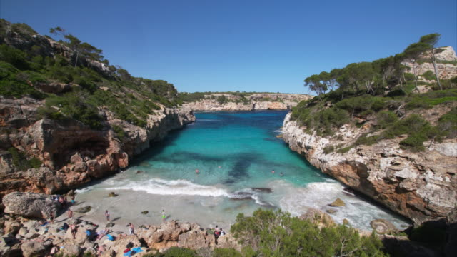 time lapse of calo des moro (cala des moro). people on the beach. - martin luther: his life and time stock videos & royalty-free footage