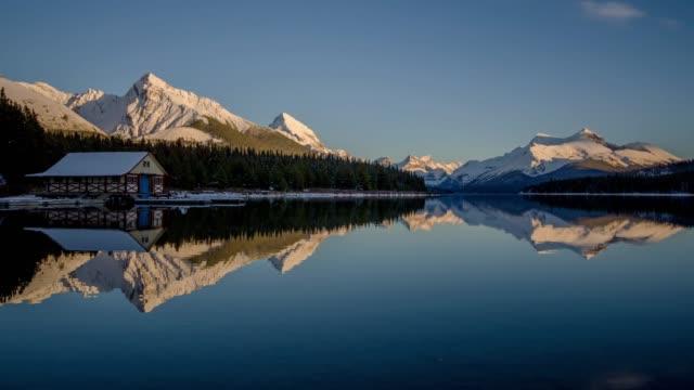 time lapse of canada lake maligne lake jasper national park , alberta , canada - calgary stock videos & royalty-free footage