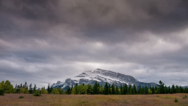 time lapse of canadian rockies , two jack lake banff canada - dramatic sky stock videos & royalty-free footage