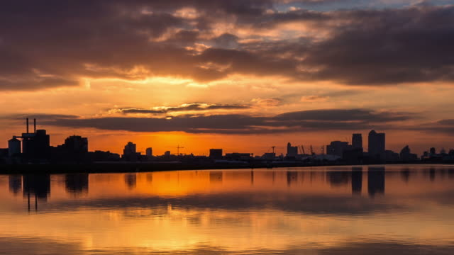 LONDON - CIRCA 2013: Time lapse of Canary Wharf and O2 arena with reflection