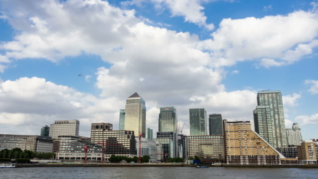 london - circa 2013: time lapse of canary wharf in london during day by the river, businness buildnigs and banks - 2013 stock videos & royalty-free footage