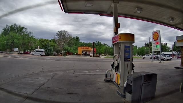 time lapse of car rear view of shell gas station opening for business in montrose, colorado, usa amid the 2020 global coronavirus pandemic - fast motion stock videos & royalty-free footage
