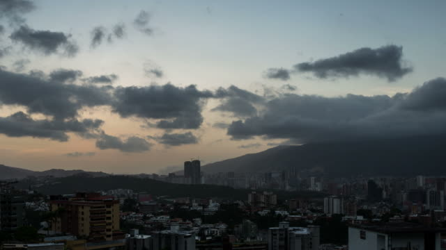 CARACAS - CIRCA 2013: Time lapse of Caracas cityline during sunset