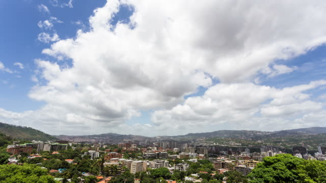 CARACAS - CIRCA 2013: Time lapse of Caracas cityline from Altamira during a cloudy sunny day