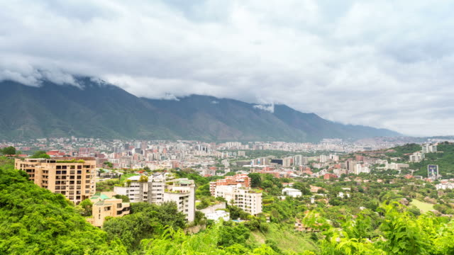 caracas - circa 2013: time lapse of caracas cityline from south during a cloudy day  - venezuela stock videos & royalty-free footage
