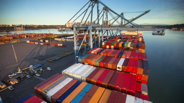 Time Lapse of Cargo Ship Seen from Moving Gantry Crane