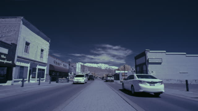 time lapse of cars driving near median on main street in small town / lehi, utah, united states - lehi stock videos & royalty-free footage