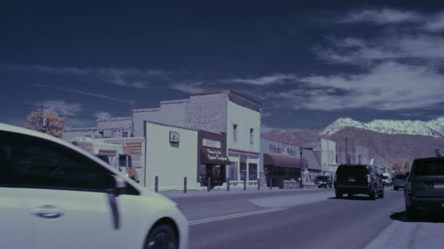 time lapse of cars driving on main street in small town / lehi, utah, united states - lehi stock videos & royalty-free footage