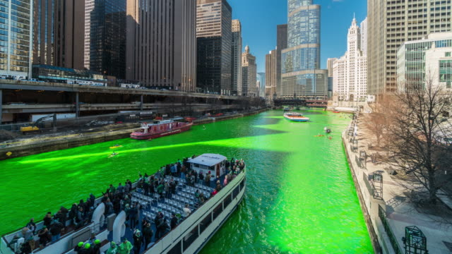 4k time lapse of celebrating st. patrick's day and dyeing chicago river shades of emerald green in chicago riverwalk, illinois, united states, irish culture and tradition concept - st. patrick's day stock videos & royalty-free footage