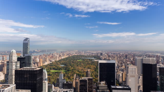 NEW YORK - CIRCA 2014: Time Lapse of Central Park and Upper Manhattan in a sunny and cloudy day from the Rockefeller