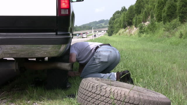 Time lapse of changing a flat tire