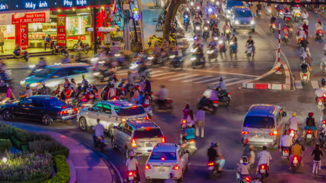Time lapse of chaotic traffic at busy roundabout. HCMC, Vietnam