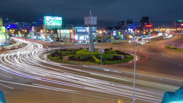 Time lapse of chaotic traffic at busy roundabout nicknamed the 'circle of death'. HCMC, Vietnam