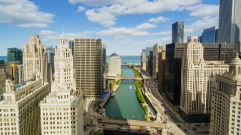 time lapse of chicago cityscape and river to lake michigan with traffic on wacker drive - wrigley building video stock e b–roll