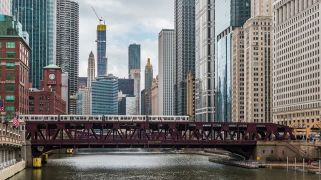 4K Time lapse of Chicago river with buildings and street bridge and riverwalk of Downtown Chicago at Michigan avenue in Chicago, Illinois, United States, Business and Modern Transportation concept