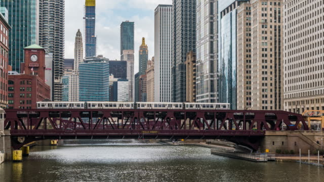 4k time lapse of chicago river with buildings and street bridge and riverwalk of downtown chicago at michigan avenue in chicago, illinois, united states, business and modern transportation concept - michigan avenue bridge stock videos and b-roll footage