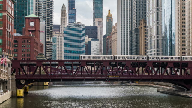 4k time lapse of chicago river with buildings and street bridge and riverwalk of downtown chicago at michigan avenue in chicago, illinois, united states, business and modern transportation concept - michigan avenue chicago stock videos & royalty-free footage