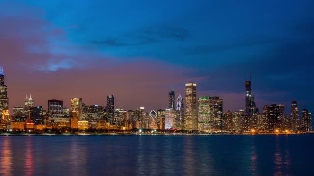 4k time lapse of chicago skyline panorama of downtown chicago with shoreline along lake michigan at beautiful nighttime in chicago, illinois, united states, business and modern architecture concept - michigan stock videos & royalty-free footage