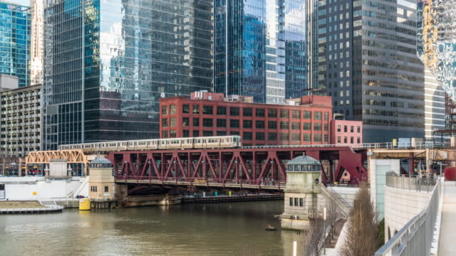 time lapse of chicago street bridge and chicago river at michigan avenue in chicago, illinois, united states - michigan avenue bridge stock videos & royalty-free footage