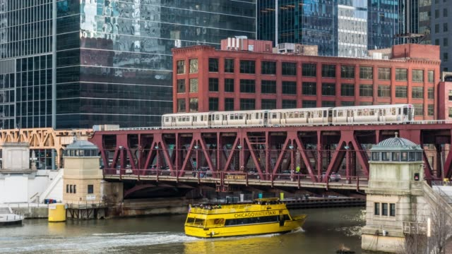 4K Time lapse of Chicago street bridge and Chicago river with traffic among modern buildings at Michigan avenue in Chicago, Illinois, United States, Business and Modern Transportation concept