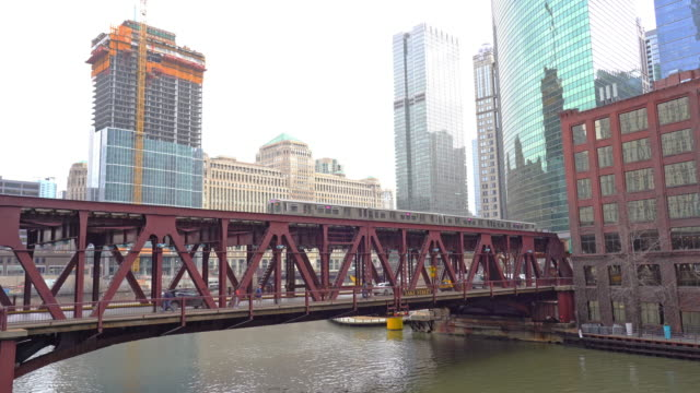 4k time lapse of chicago street bridge and chicago river with traffic among modern buildings at michigan avenue in chicago, illinois, united states - michigan avenue bridge stock videos & royalty-free footage