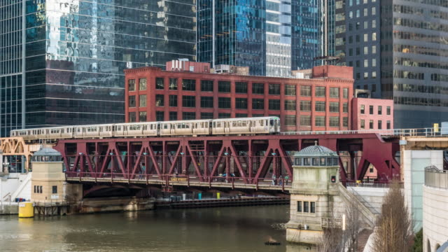 4k time lapse of chicago street bridge and chicago river with traffic among modern buildings at michigan avenue in chicago, illinois, united states, business and modern transportation concept - michigan avenue bridge stock videos and b-roll footage