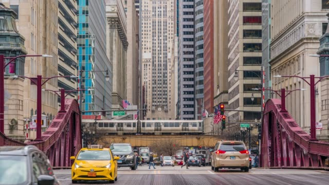 4k time lapse of chicago street bridge with traffic among modern buildings of downtown chicago at michigan avenue in chicago, illinois, united states, business and modern transportation concept - michigan avenue bridge stock videos and b-roll footage