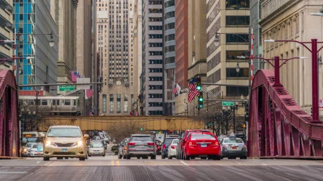 4k time lapse of chicago street bridge with traffic among modern buildings of downtown chicago at michigan avenue in chicago, illinois, united states, business and modern transportation concept - michigan avenue chicago stock videos & royalty-free footage