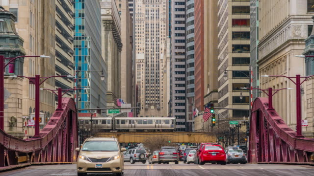 4k time lapse of chicago street bridge with traffic - michigan avenue bridge stock videos and b-roll footage