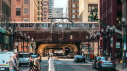 4K Time lapse of Chicago street with traffic road intersection in rush hour among modern buildings of Downtown Chicago at Michigan avenue in Chicago, Illinois, United States, Business and Modern Transportation concept