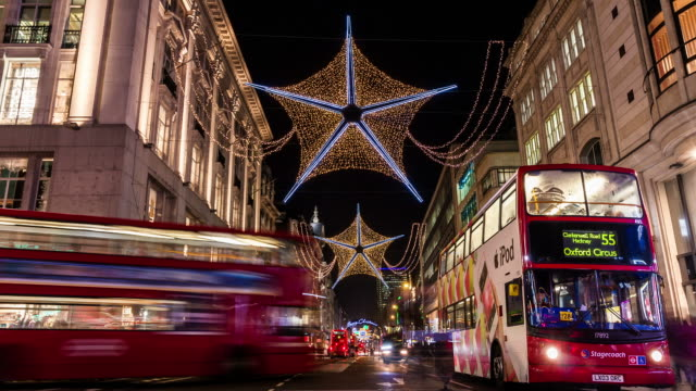 LONDON -CIRCA 2012: Time Lapse of Christmas light in a rush hour at Oxford Circus Station in London.