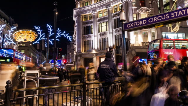 london- circa 2012: time lapse of christmas light in oxford street in london with people shopping and traffic in london. - oxford circus stock videos and b-roll footage