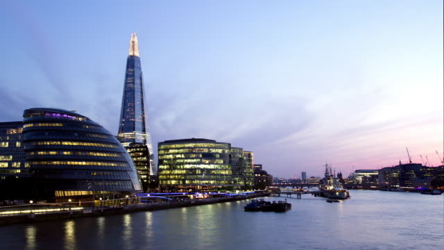 ws  time lapse of city hall , the shard and river thames transition dusk to night - gla building stock videos & royalty-free footage