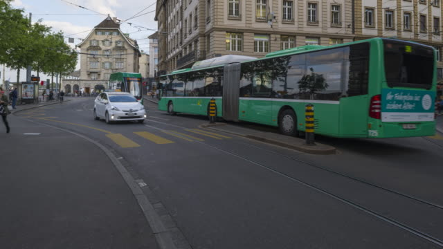 Time Lapse of city life with pedestrians, bus, tram and cyclists in the city of Basel. Basel, Switzerland, Europe.