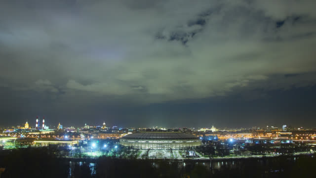 time lapse of cityscape at twilight - luzhniki stadium stock videos & royalty-free footage