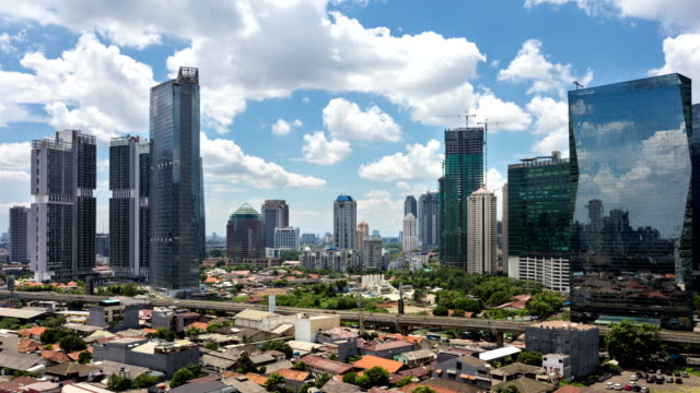 time lapse of clouds above jakarta business district - newly industrialized country stock videos and b-roll footage