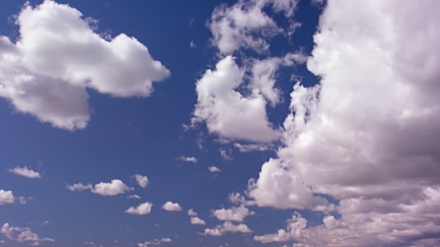 Time lapse of clouds against a blue sky, daytime