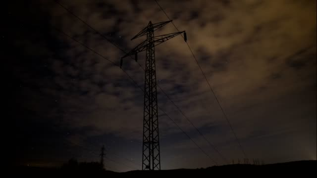 4k time lapse of clouds and electricity, nightscape, starry sky, high voltage line, clear blue sky, sun rays, cloudscape, springtime, beauty in nature, freedom, wind, industry, electricity - power equipment stock videos & royalty-free footage