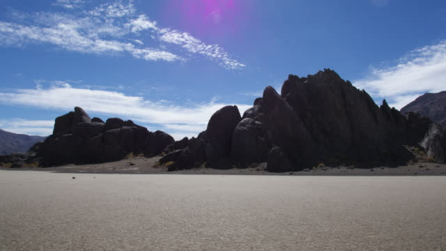 time lapse of clouds and rock at racetrack playa, death valley - death valley national park stock videos & royalty-free footage