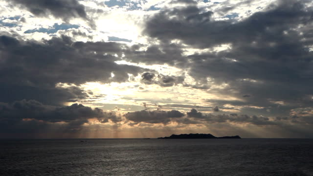 time lapse of clouds and shining sun over the sea - rx stock videos & royalty-free footage